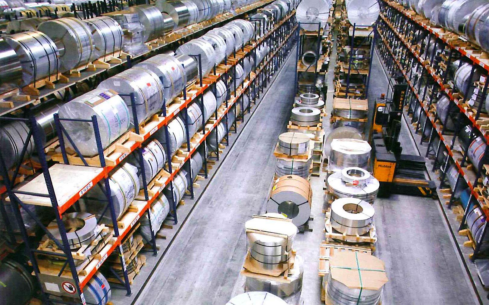 Hubtex Electric Multidirectional Sideloader in narrow aisle coil pallet racks