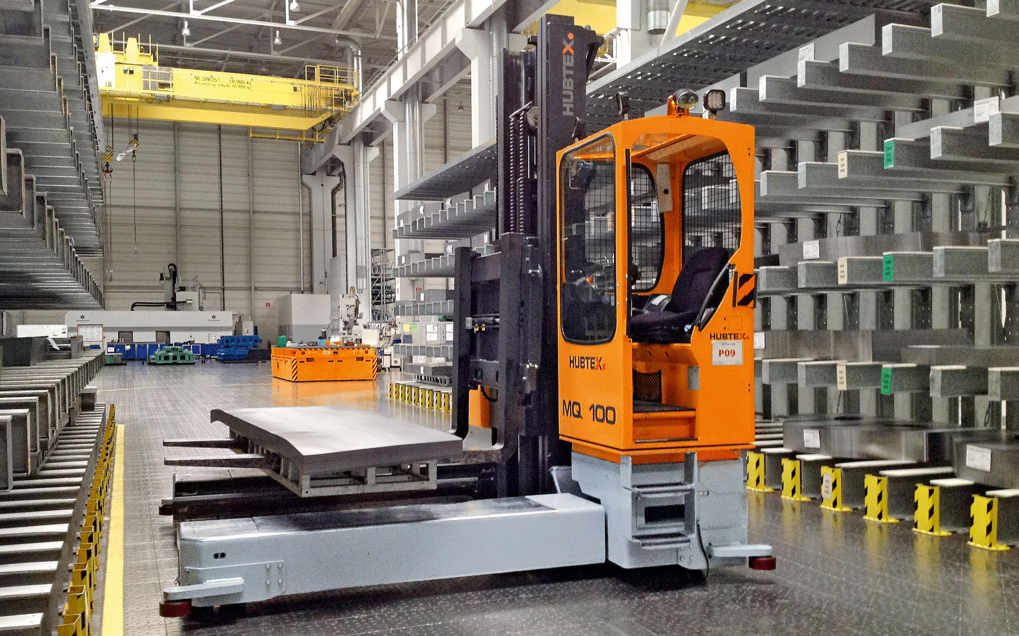 Hubtex MQ 100 Electric Multidirectional Sideloader placing product