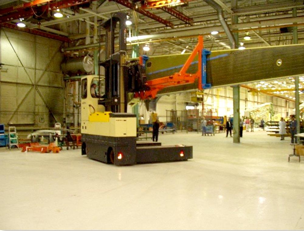 Hubtex Electric Multidirectional Sideloader handling a wing