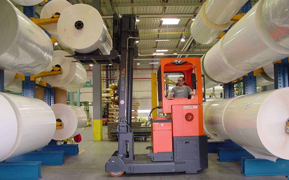 HUBTEX Reach Truck loading rolled plastic on to rack
