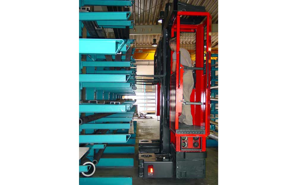 Hubtex model MU-SO two-man order picking metal shapes off cantilever racking in a narrow aisle