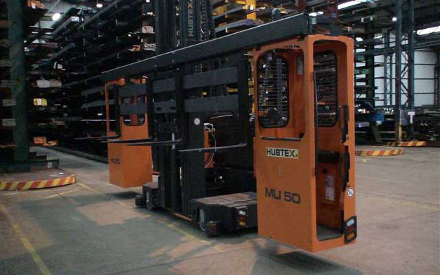 Hubtex model MU-SO two-man order picker entering narrow aisle of cantilever rack