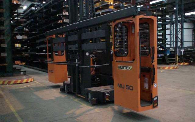 Hubtex model MU-SO two-man order picker entering narrow aisle of cantilever rack