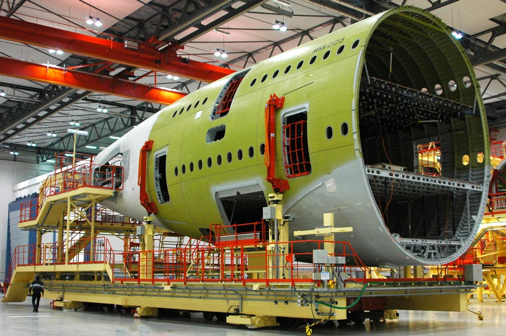 Automated Guided Vehicle moving the fuselage of an aircraft
