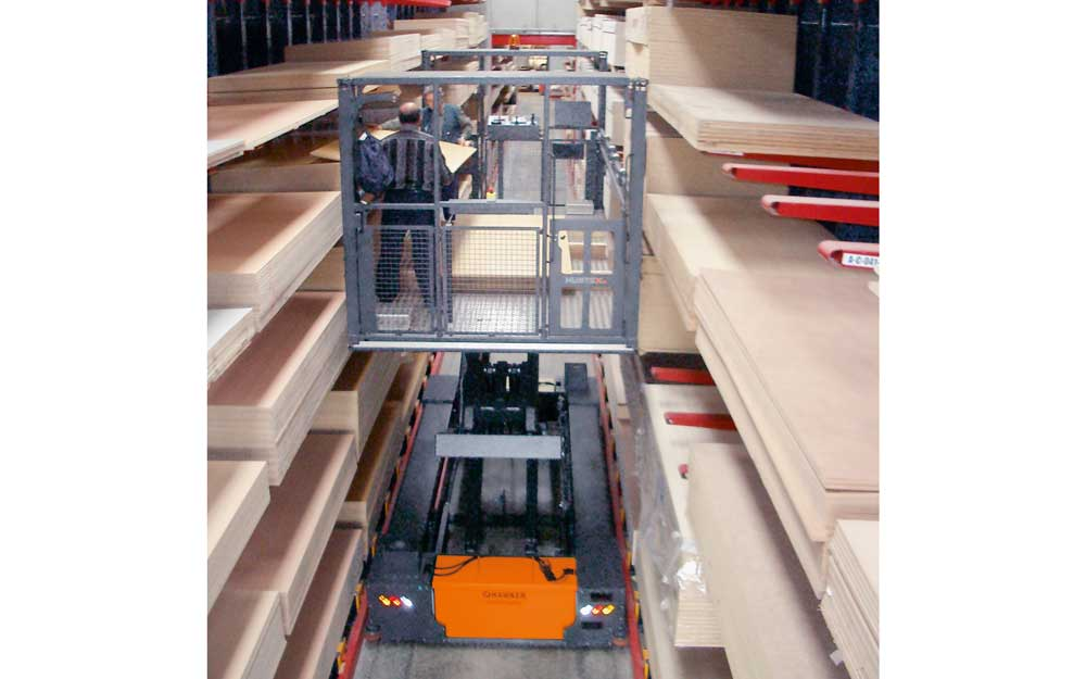 Hubtex EZK Order Picker with order picking platform picking sheets from both sides in a narrow aisle