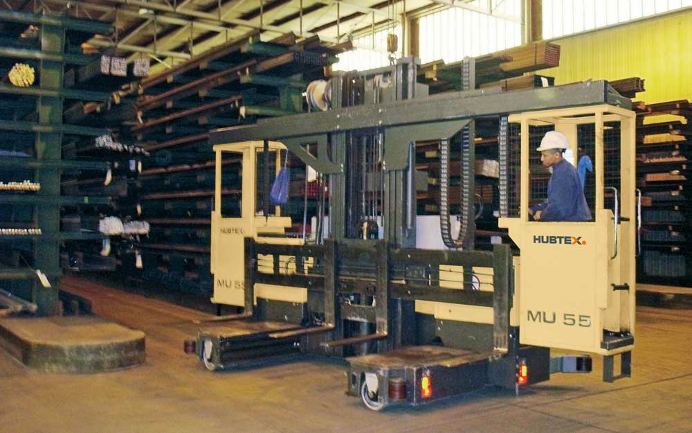 Hubtex model MU-SO two-man order moving into a narrow aisle of off cantilever racking