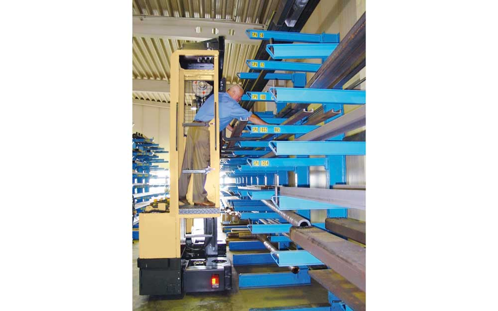 Rob Alling on a Hubtex MU SO order picker picking product off a cantilever rack