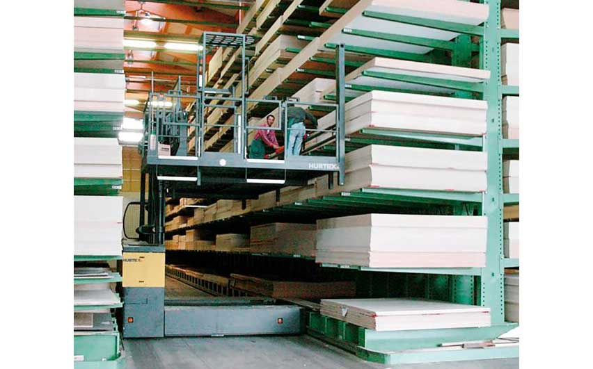 Hubtex KP Order Picking System with removable order picking platform picking sheets of wood