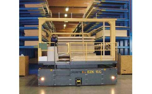 Hubtex EZK Order Picker with order picking platform entering a narrow aisle