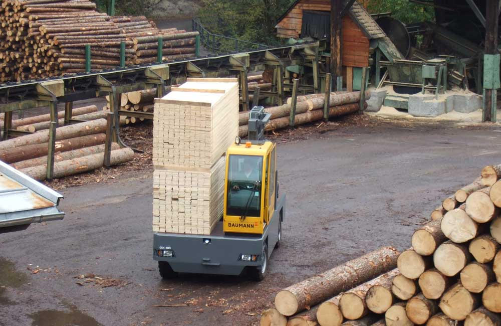 Baumann GX 50 traveling with a very large load of finished lumber