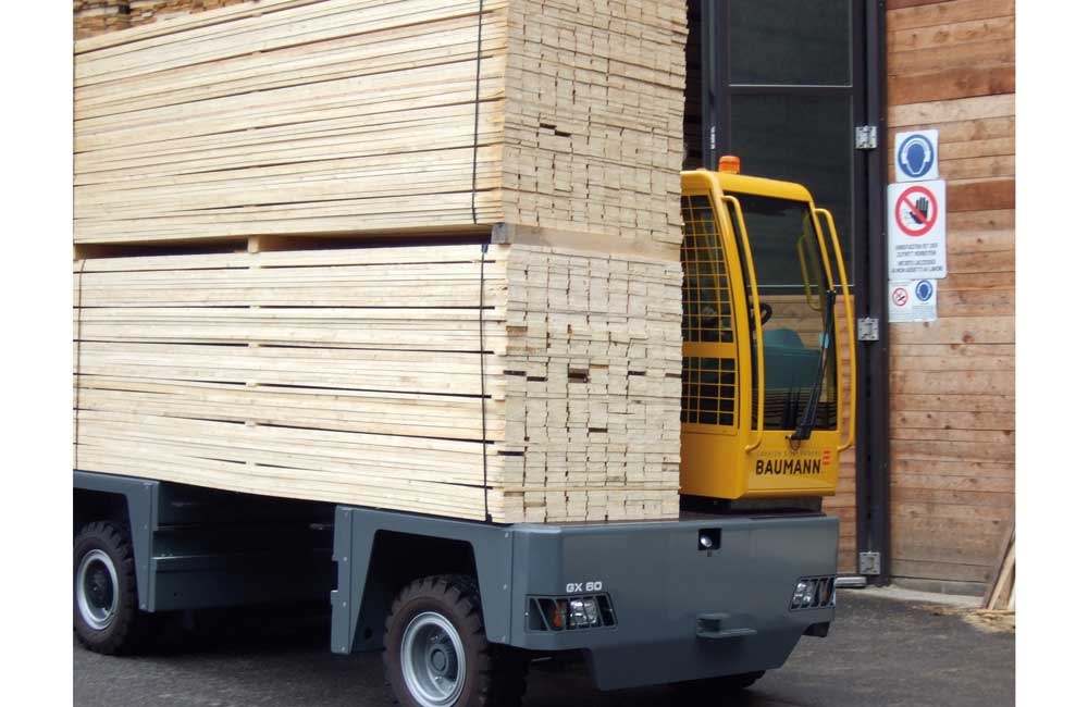 Baumann GX 60 carrying double load of lumber out doors