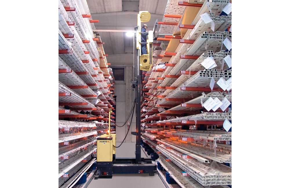 Hubtex Electric Multidirectional Sideloader order picker picking plastic pipe from cantilever rack