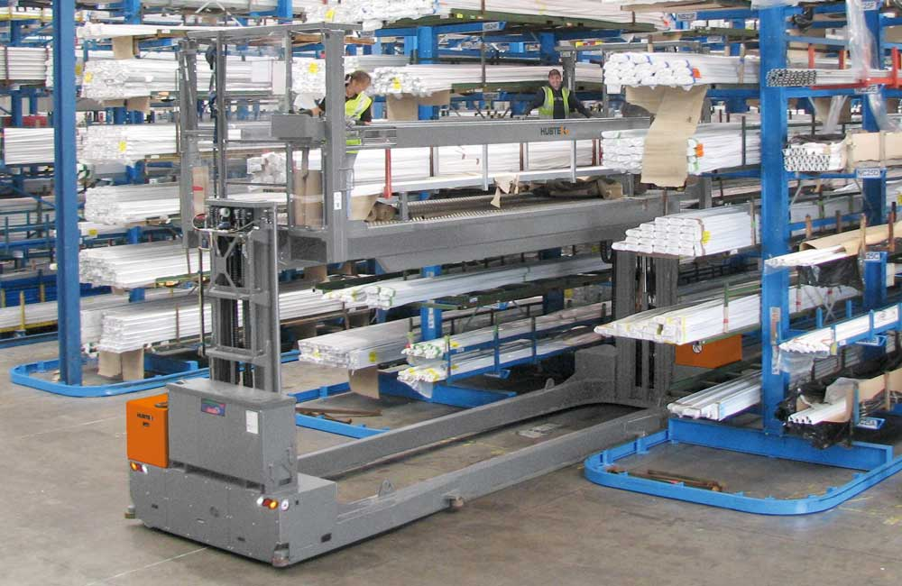 Hubtex EZK Electric Multidirectional Sideloader order picker picking plastic extrusions from cantilever rack