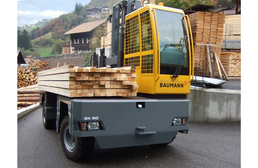 Baumann GX 60 carrying a load of lumber on a road