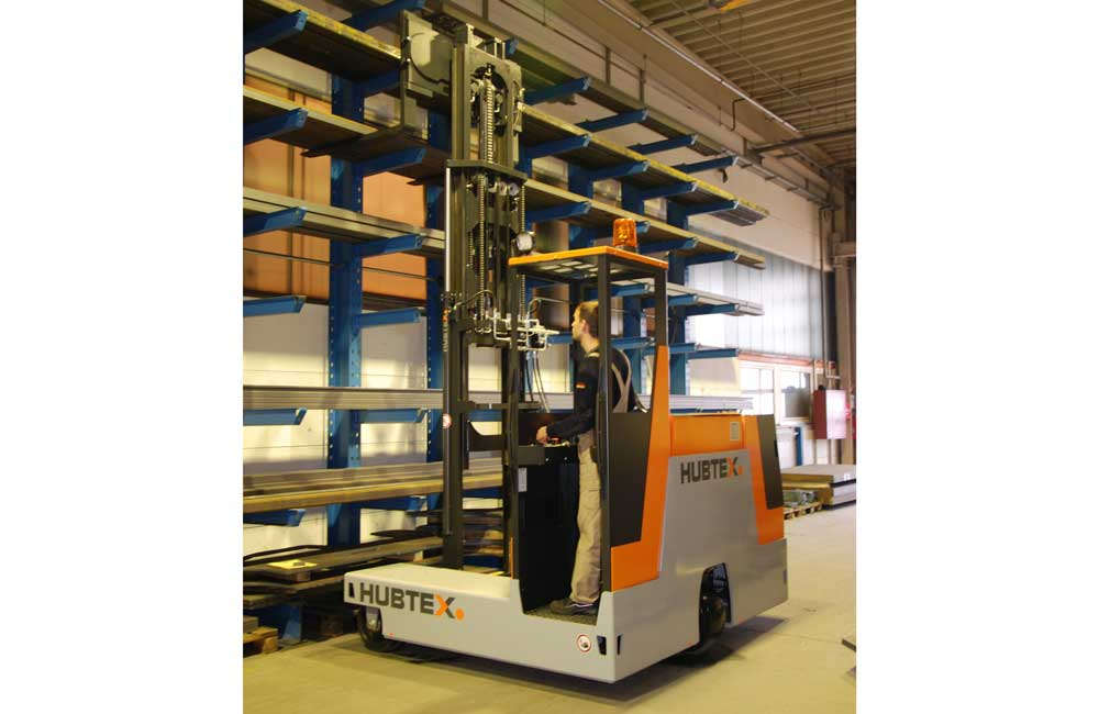 Hubtex 3-Wheel Electric Multidirectional Sideloadermoving product from cantilever rack